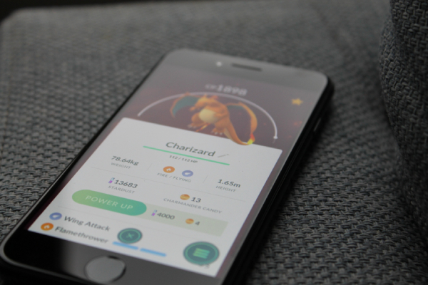 A smartphone showing a Charizard in the Pokemon Go game